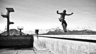 Boy skating against a mountain backdrop