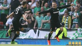 Celtic players celebrate after scoring goal