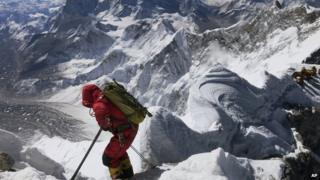 Climber scaling Mount Everest.