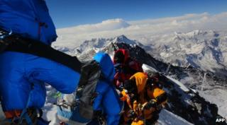 Climbers on the summit of Mount Everest