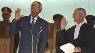 Nelson Mandela takes his presidential oath of office in 1994