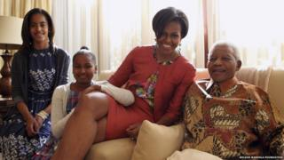 Nelson Mandela with Michelle Obama and her daughters in 2011