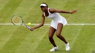 Venus Williams playing on grass court