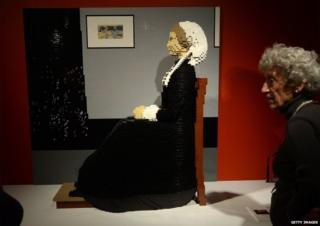 Lego sculpture based on a famous painting known as Whistler's Mother by American artist James Whistler.