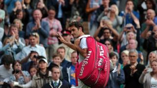 Roger Federer walks off centre court