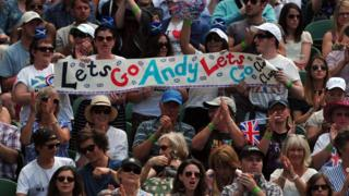 Fans hold banner supporting Murray.