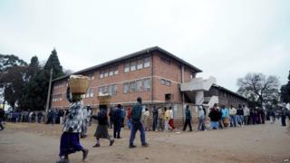 Zimbabweans line up near a polling station