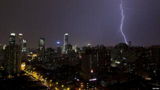 Lightning is seen above buildings during a storm in central Shanghai July 31, 2013