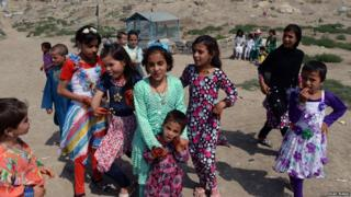 Children wearing new clothes in Afghanistan