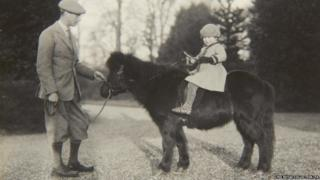 Previously unpublished family photograph issued by the Royal Collection of Queen Elizabeth II with nthe Duke of York on Shetland pony, Peggy in 1930.