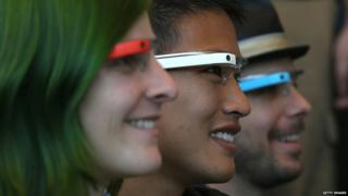 Attendees wear Google Glass while posing for a group photo during the Google I/O developer conference