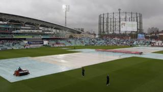 The Kia Oval is covered to protect against rain during the fifth Ashes Test between England and Australia on 22 August 2013