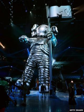 Moonman designed by artist KAWS on display during a press conference for the 2013 MTV Video Music Awards at the Barclays Center on August 22, 2013