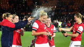 Arsenal Ladies celebrate their win against Lincoln in the Continental Cup.