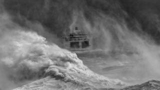 Photograph of a ferry leaving Newhaven harbour in a storm by David Lyon