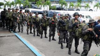 Troops prepare to leave Manila for Tacloban.