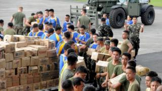 Relief goods are prepared for transport at the military base in Manila. They will be sent to Tacloban which has been badly hit.