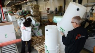 French workers from Doctors without Borders prepare emergency aid for the Philippines.