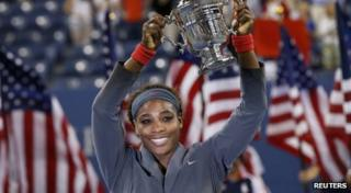Serena Williams lifts the U.S Open Trophy