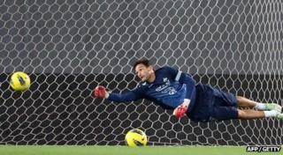 Hugo Lloris saves a ball during France training