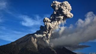 Powerful bursts of hot ash and rocks erupting from Mount Sinabung in Indonesia. Local people have been warned to stay at least 3 miles away from the crater of the volcano.