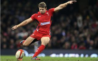 Leigh Halfpenny kicking during a rugby game