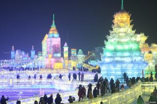 Ice sculptures resembling skyscrapers and a temple