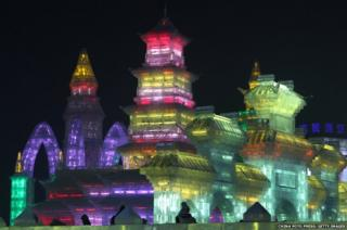A city made of ice, illuminated in a rainbow of colours