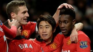 Danny Welbeck celebrates with teammates