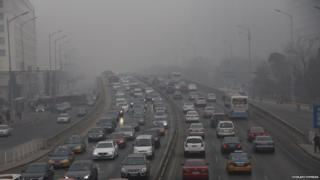 Smog covers a busy highway in Beijing