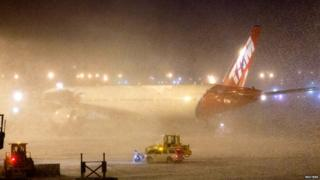 TAM airlines plane sits shrouded by snow