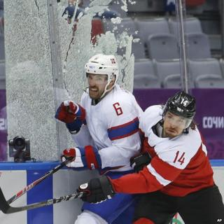 Shattered glass during Austria v Norway ice hockey game
