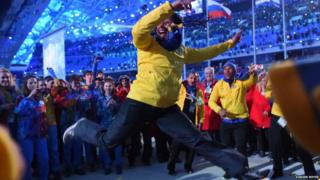 Brazil's bobsleigh athlete Sally Mayara da Silva dancing in a crowd of people