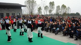 people dressed as pandas dancing