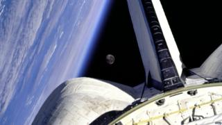 The Earth and Moon are nicely framed. This picture was taken from the aft windows of the Space Shuttle Discovery in 1998.