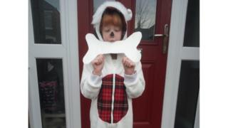 Lily, who's 8, is dressed as Snowy the dog from the Tin-Tin books.