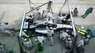 The pit crew for Mercedes driver Nico Rosberg of Germany change his tires.