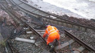 Engineer working on getting the rail line fixed