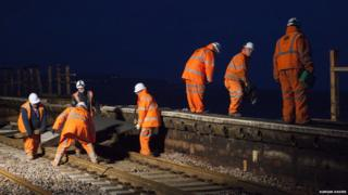 "The ""orange army"" working round the clock to get the line back up and running"