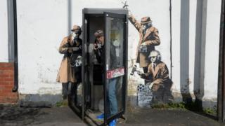 Banksy's Spy Booth artwork in Cheltenham