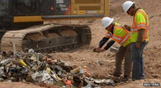 Workers excavate the video games