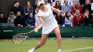 Elena Baltacha hits a forehand during the Ladies Singles match against Flavia Pennetta of Italy at Wimbledon in 2013