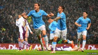 Manchester City players celebrating