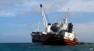 Handout picture released by Galapagos National Park showing an Ecuadoran freighter which ran aground