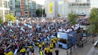 Manchester City team on open top bus parade