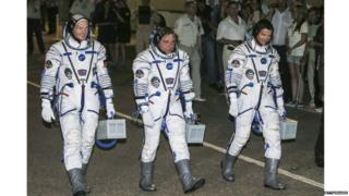 The three space men on board are Commander Maxim Suraev of the Russian Federal Space Agency, Flight Engineer Alexander Gerst of the European Space Agency, and Flight Engineer Reid Wiseman of NASA.