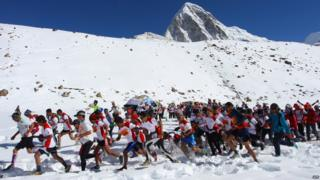 Runners start off on their 26.2 mile run down Mount Everest.