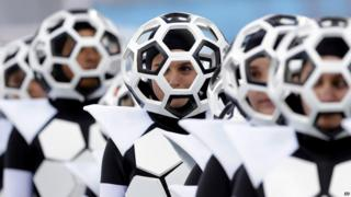 Dancers dressed as footballs