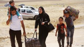 Family flee violence in Iraq