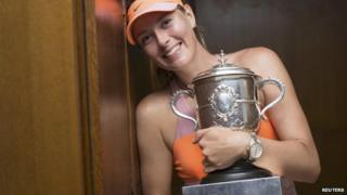 Maria Sharapova holding French Open trophy